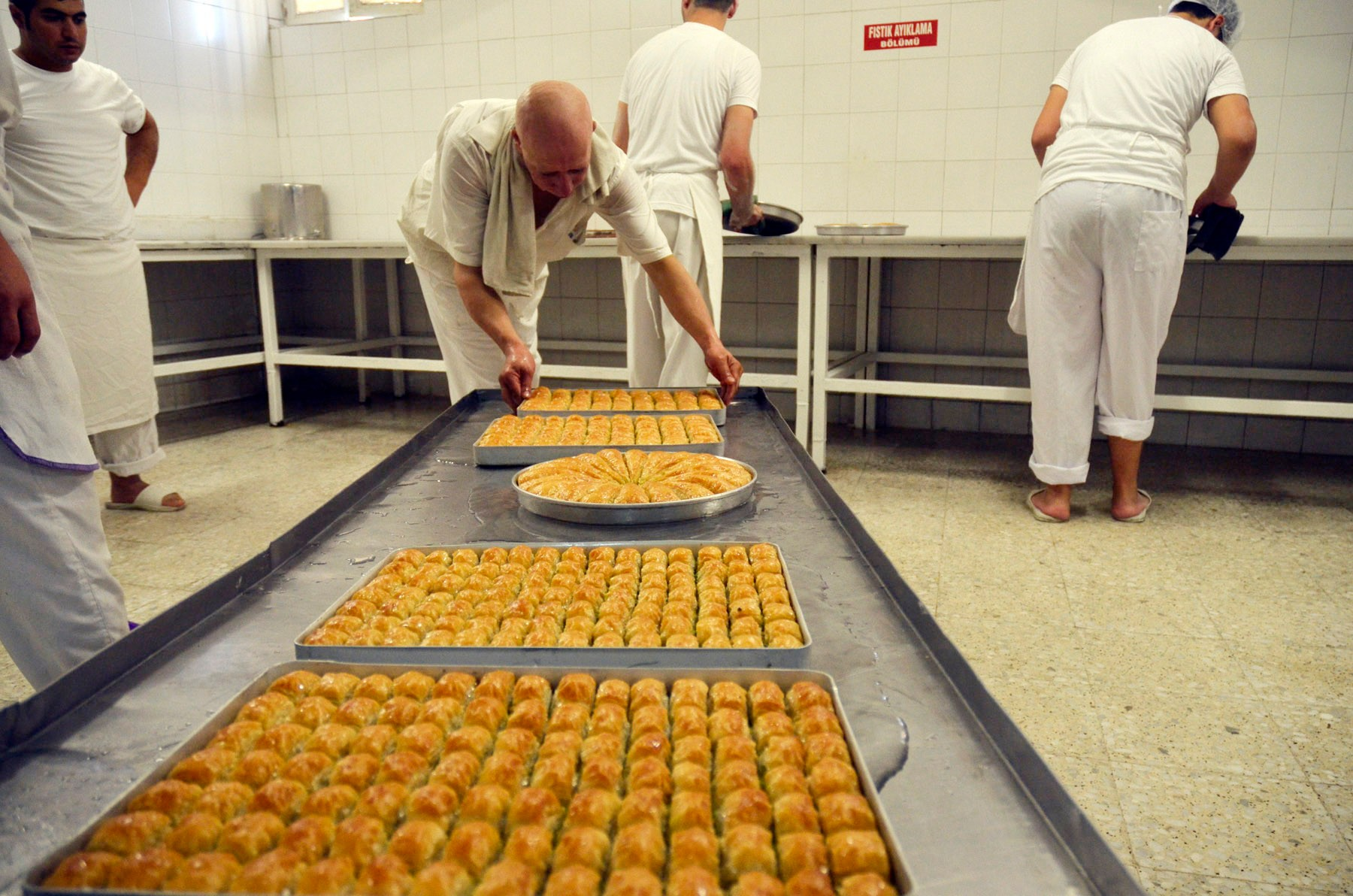 Baklava is put on cold water once its taken out of the oven