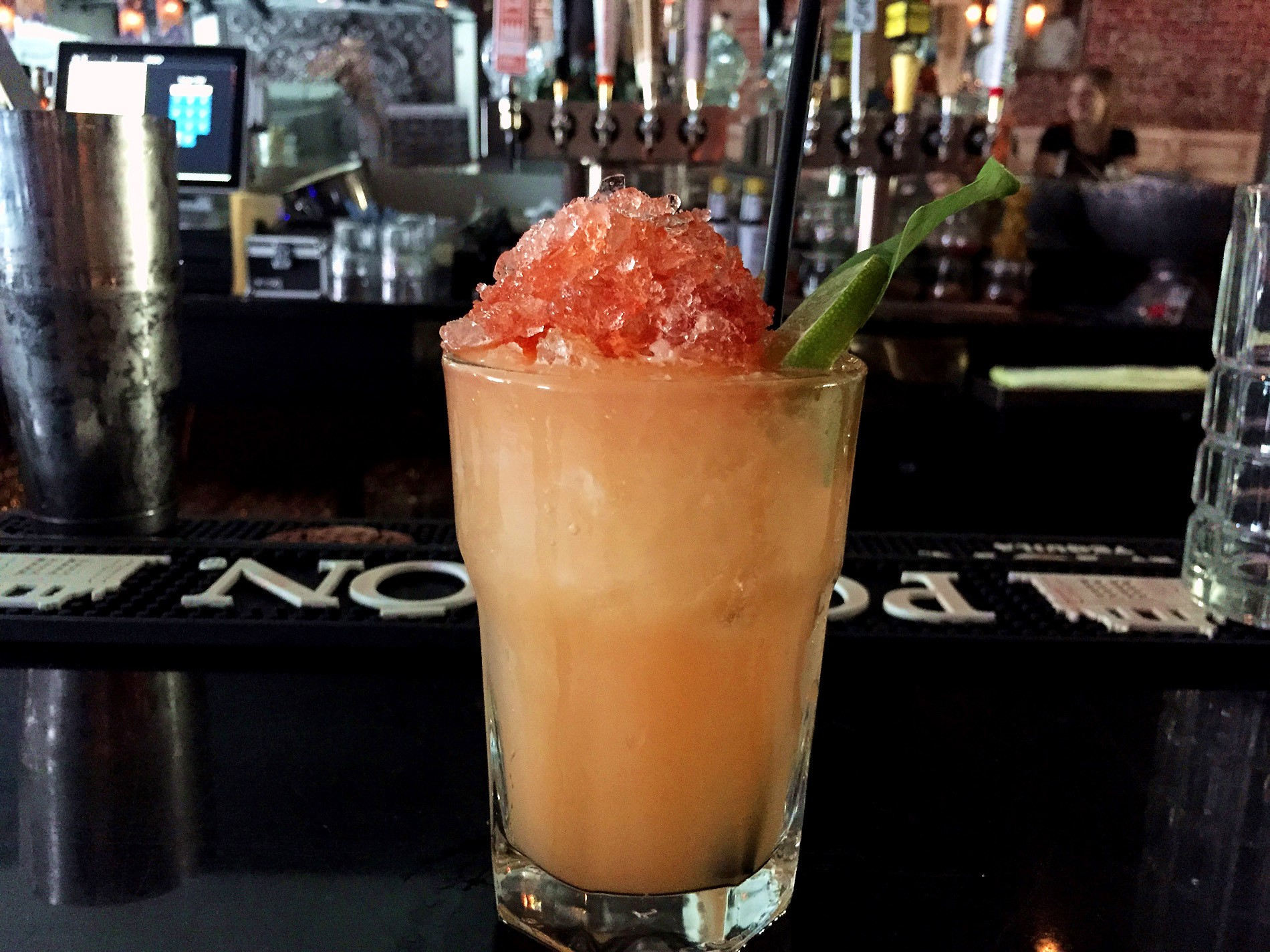 Manahan's Sneaky Tiki includes Claro rum, Lillet Blanc, fresh-squeezed mandarin and lime juice, orgeat, Angostura bitters, and lots of crushed ice.
