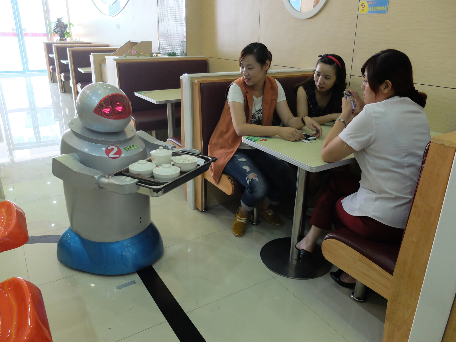 Girls at table with robot