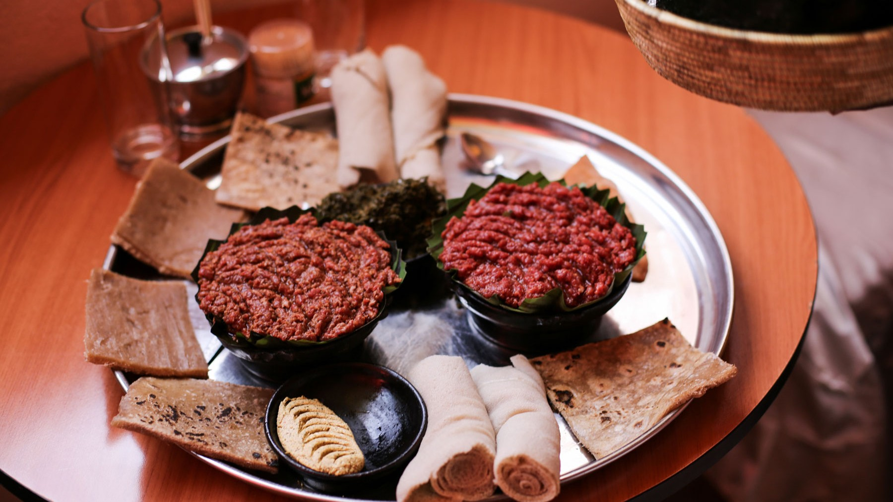 Leb-leb-(left)-is-slightly-cooked-and-kitfo-(right)-is-warmed-raw-minced-meat