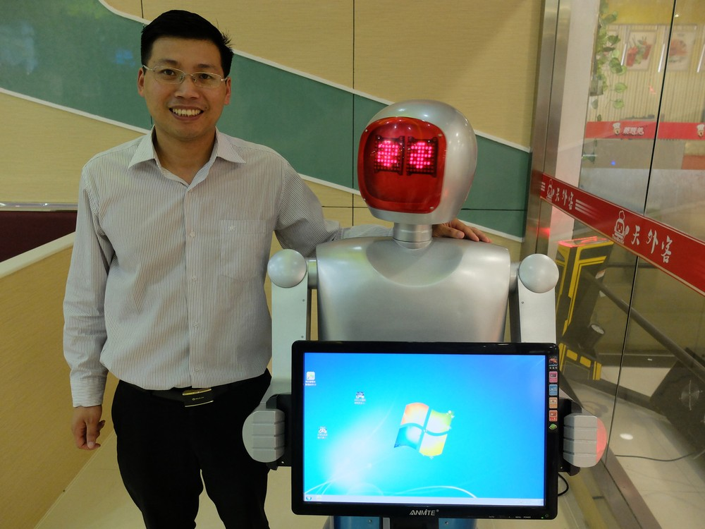 Owner with menu robot