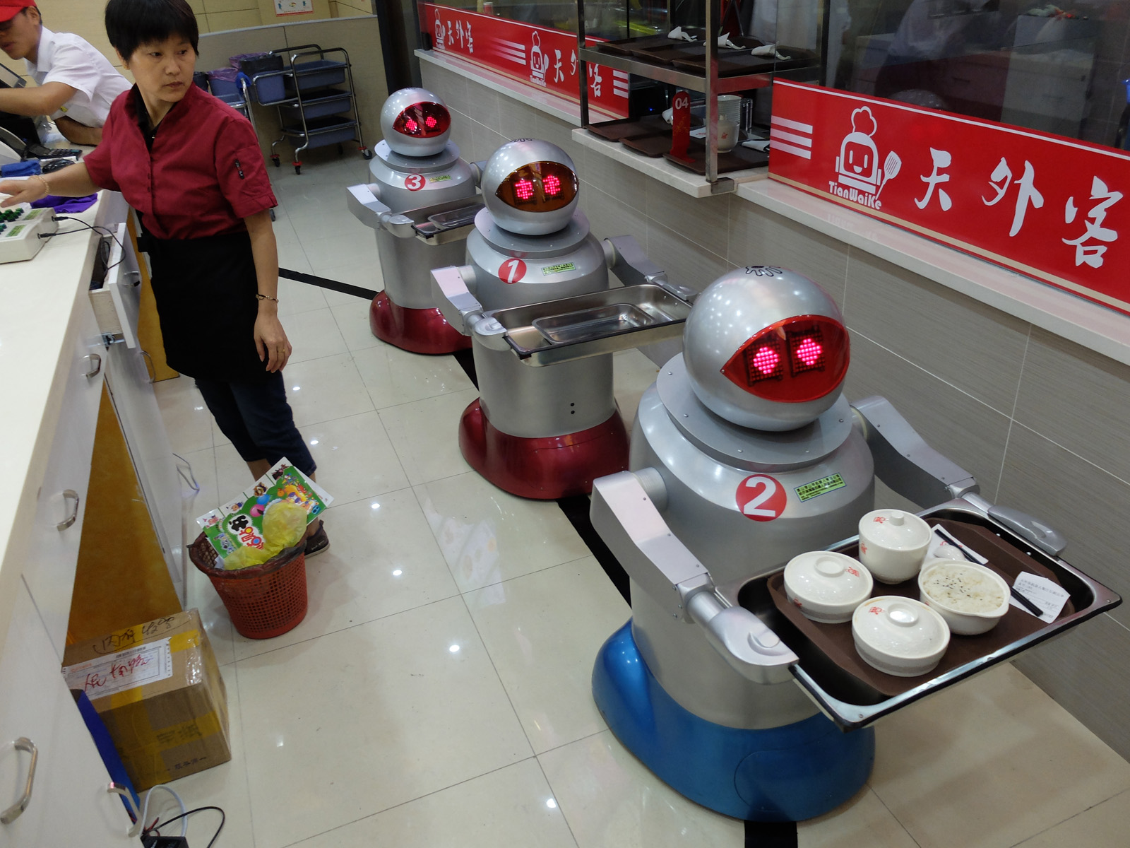 Three robots behind the counter