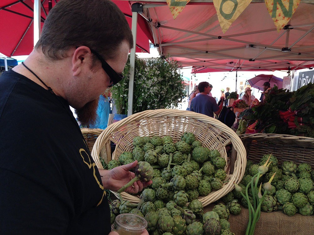 Scoping out the artichokes at the market