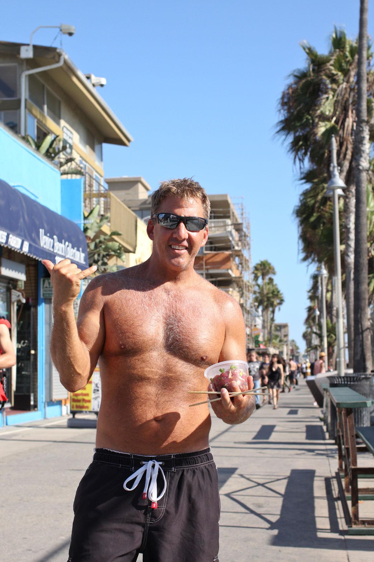 muscle-beach-man-on-boardwalk