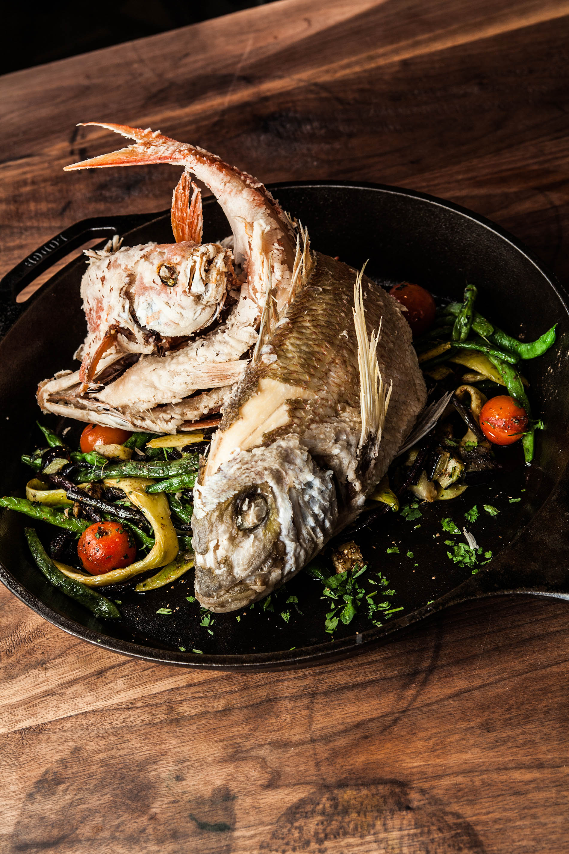 Crispy whole Vermillion snapper and long tail bass with masala vegetables. Photo courtesy of Julie Soefer Photography