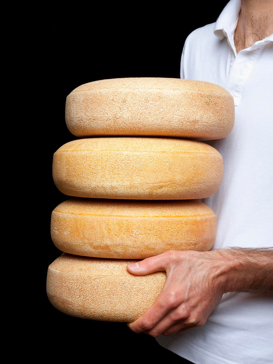 uplandscheese_andy-with-stack-of-wheels