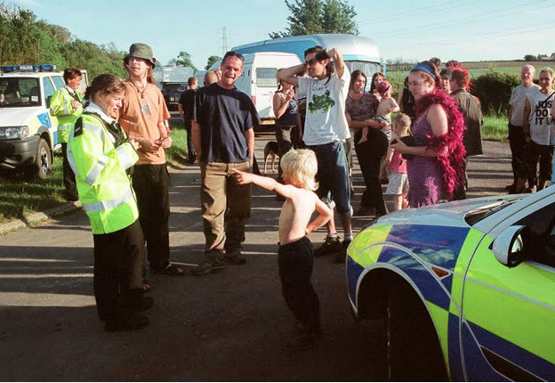 Some police looking less threatening at a rave in Somerset.