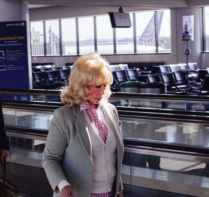 Photos of Sad People Doing Nothing in Particular in Airports